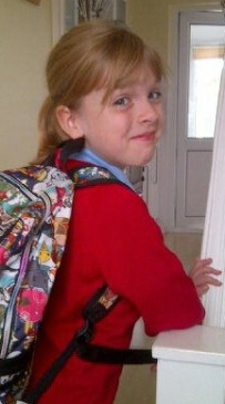 TK's first day at Junior School - within a year she had stopped reading for pleasure.